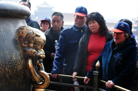 majority: BEIJING - MARCH 11:Visitors at the The Forbidden City on March 11 2009 in Beijing,China.The palace museum serving as a treasure house of majority of the ancient Chinese historical and cultural relics. Editorial