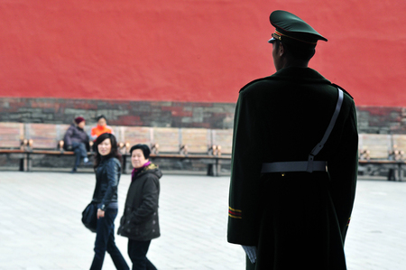 compulsory: BEIJING - MARCH 11:Chinese soldier guards inside the Forbidden City on March 11 2009 in Beijing,China.Military service in China is compulsory, in theory, for all men who attain the age of 18