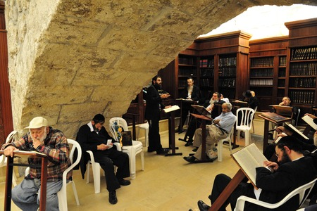 hassid: JERUSALEM - JULY 20:Jewish people pray in The Cave Synagogue at the Western wall on July 20 2009 in Jerusalem, Israel. Traditionally, it is regarded as the only remnant of the Jewish Temple.