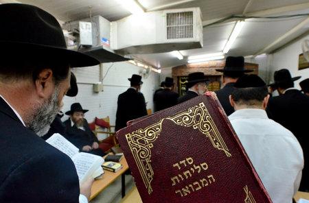 ASHDOD - SEPTEMBER 15 : Ultra orthodox Jewish men pray in a synagogue before Yom Kippur on September 15 2010 in Ashdod Israel.