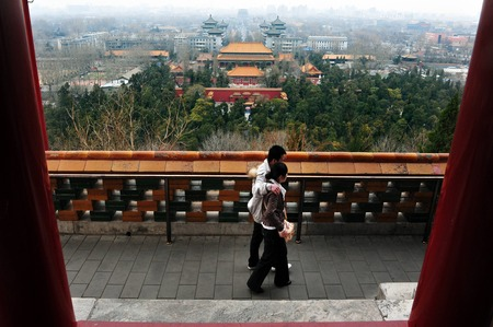 people's cultural palace: BEIJING - MARCH 11:Chinese couple on top of Jingshan Park on March 11 2009 Beijing, China.Its a 45.7m high artificial hill that constructed by Ming Dynasty of an area of more than 230,000 m