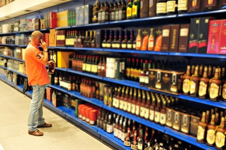 intoxicating: Liquor store selling alcohol and wine.