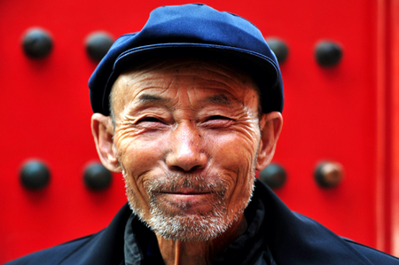 old man smiling: BEIJING - MARCH 11:Chinese man at the Forbidden City on March 11 2009 in Beijing,China. The average life expectancy among Chinese men is 72 years Editorial