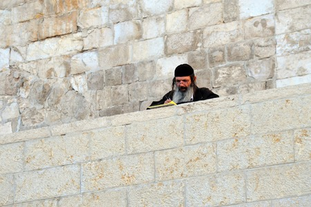 hassid: JERUSALEM  - NOV 05:Jewish Man pray at the Western Wall on November 05 2011 in Jerusalem, Israel.Its the most sacred site by the Jewish faith outside of the Temple Mount itself. Editorial