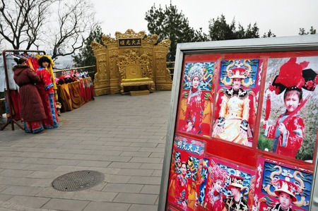 people's cultural palace: BEIJING - MARCH 11:Chinese women wearing costumes at Jingshan Park on March 11 2009 Beijing, China.Its a 45.7m high artificial hill that constructed by Ming Dynasty of an area of more than 230,000 m Editorial