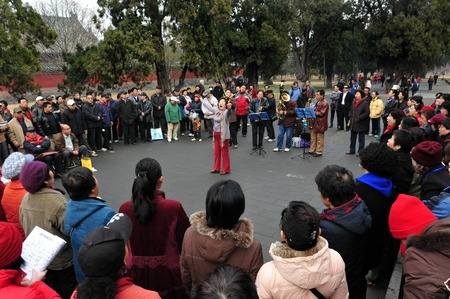 play popular: BEIJING-MARCH 15:Chinese people play music and singing at the temple of heaven park on Mar 15 2009 in Beijing, China.Its the most popular park in Beijing used by thousands of people for sport and leisure daily