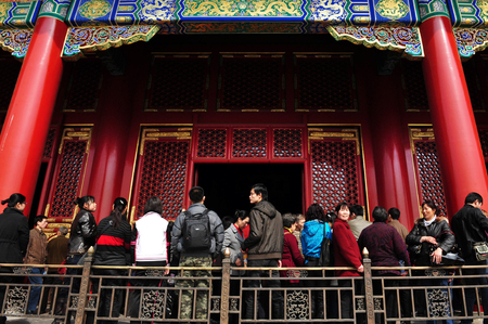 palatial: BEIJING - MARCH 11:Visitors at the The Forbidden City on March 11 2009 in Beijing,China.It is Chinas best-preserved imperial palace and is known to be the worlds largest ancient palatial structure. Editorial