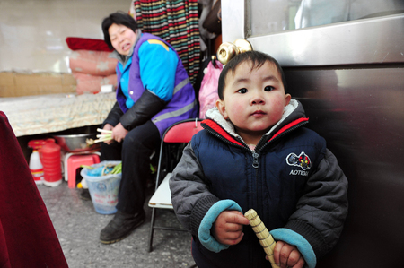 one child: BEIJING - MARCH 13:Chinese baby and his mother at home in Hutong on Mar 13 2009 in Beijing, China.When One Child Policy was adopted in 1979,Chinas population was about 972 million. Today its about 1.343 billion people.