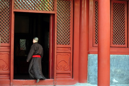 BEIJING - MAR -13: Buddhist tibetan monk in the Lama Temple on March 13 Beijing, China.It is one of the largest and most important Tibetan Buddhist monasteries in the world. Editorial