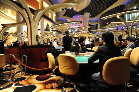 An indoor night scene of a casino in Macau, China.