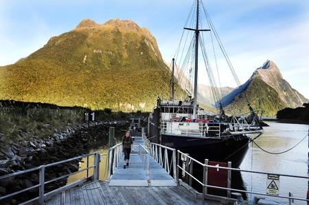 mitre: FIORDLAND, NZ- FEB 28:Cruise boat in Milford Sound on February 28 2009.Its one of the most dramatic and beautiful parts of New Zealand and the largest of NZ national parks with an area of 12,500 km. Editorial