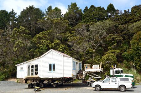 transfer pricing: MANGONUE, NZ - OCT 05:Transporting an old house to a new location on Oct 05 2013.The cost of buying an old house for removal can range from a few thousand dollars to over 100,000 for a large home.