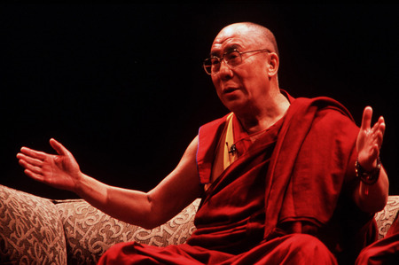 AUCKLAND - APRIL 10 2003: His Holiness the 14th Dalai Lama of Tibet is giving a speech in Auckland  New Zealand in April 10 2003.He has lived in exile in India since the Chinese Army crushed an uprising in his homeland in 1959.