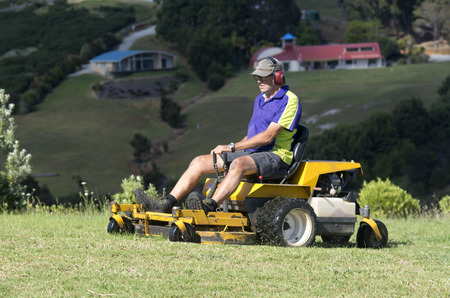 estimates: CABLE - BAY NOV 04: Man rides on lawn mower on Nov 04 2013.By industry estimates about 40 million mowers are in use on any given summer day. Editorial