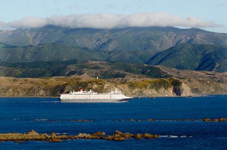 each year: WELLINGTON - FEB  23:A cruise ship near Wellington, NZ on Feb 23 2013.Wellington has approximately 540,000 international visitors each year, who spend 436 million each year.