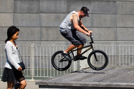 bmx bike: WELLINGTON - FEB 24: Young man is jumping with his BMX Bike on February 24 2013 in at Wellington waterfront, NZ. It became official Olympic sport in the 2008 Summer Olympic Games in Beijing, China.