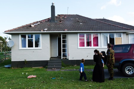 damaged roof: AUCKLAND - DEC 7:Victims and their properties after a rare tornado ripped through Hobsonville in Auckland, New Zealand on December 7, 2012.It killed 3 and 250 people were left homeless and without power.