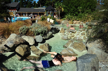 nz: HANMER,NZ - MAR 15: Tourists enjoying hot pools in Hanmer springs on March 15 2009.Hanmer Springs is a very popular tourist destination in the south Island of NZ.