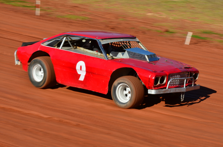stock car: TAIPA, NEW ZEALAND - JUNE 02 2012: A street stock car during a dirt track racing on June 02 2012 in Taipa speedway, New Zealand.