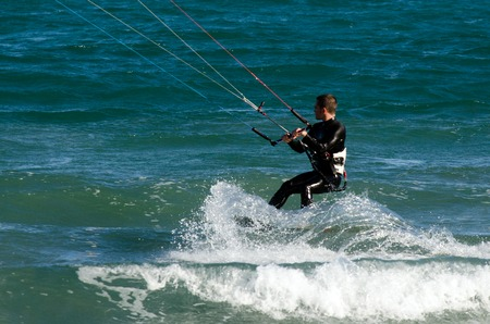 waterskiing: WELLINGTON - FEB 23: Man Kitesurfing on February 23 2013 in Lyall  Bay, Wellington New Zealand. In 2012, the number of kitesurfers estimated to 1.5 million persons world wide.