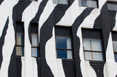 wellington: WELLINGTON - FEB 24: Wellywood Backpackers building on February 24 2013 in Wellington NZ.The  distinctive zebra painted building is one of Wellington known landmarks.