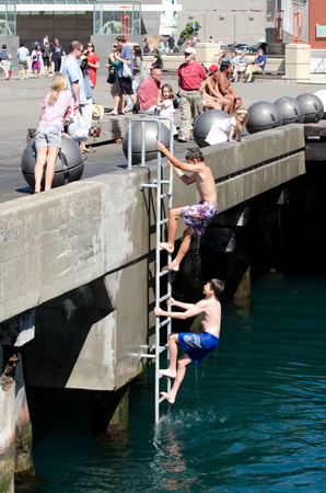 visitors area: WELLINGTON - FEB 24 : Visitors in Wellington Waterfront on February 24 2013. Wellington is the capital city and second most populous urban area of New Zealand as It is home to 395,600 residents.