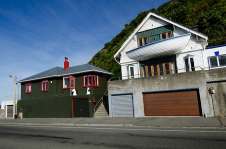 wellington: WELLINGTON - MAR 03: Waterfront novelty home in Wellington, New Zealand. The special house balcony was designed from a fishing boat.
