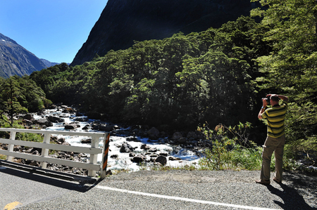 nz: FIORDLAND, NZ- FEB 28:Tourist explores Fiordland on February 28 2009.Its one of the most dramatic and beautiful parts of New Zealand and the largest of NZ national parks with an area of 12,500 km.