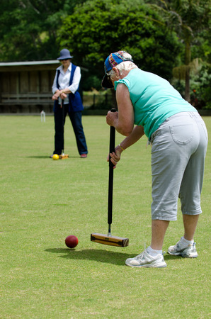 footing: TAIPA  - NOVEMBER 28: Croquet players plays Croquet in Taipa club in Northland, New Zealand on November 28, 2012. Croquet was the first outdoor sport to embrace equality, allowing both sexes to play the game on an equal footing. Editorial