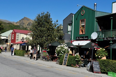 gold mining: ARROWTOWN, NZ - FEB 10: Visitors in Arrowtown on February 10 2009. Arrowtown is a historic gold mining town in the Otago region of the South Island of New Zealand.