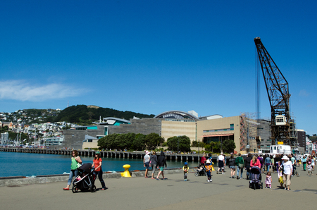 australasia: WELLINGTON - FEB 24: Visitors at Wellington Waterfront on February 24 2013. Wellington is the capital city and second most populous urban area of New Zealand as It is home to 395,600 residents. Editorial
