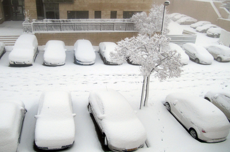 precipitation: JERUSALEM - JAN 10:Cars in parking lot covers in snow on Januart 10 2013 in Jerusalem, Israel. The biggest snowstorm since 1992 pounds capital, paralyzing transportation and bringing more than 20 cm of precipitation.