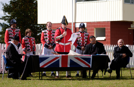 public holiday: KAITAIA- FEB 6:British people reenact the signing of the treaty of Waitangi on February 6 2005 in Kaitaia NZ.Its New Zealand public holiday to celebrate the signing of the Treaty of Waitangi in 1840