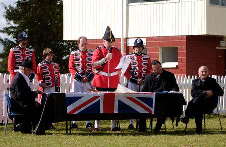 aotearoa: KAITAIA- FEB 6:British people reenact the signing of the treaty of Waitangi on February 6 2005 in Kaitaia NZ.Its New Zealand public holiday to celebrate the signing of the Treaty of Waitangi in 1840