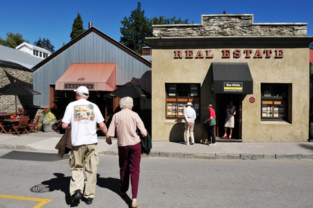 mining town: ARROWTOWN, NZ - FEB 10: Visitors in Arrowtown on February 10 2009. Arrowtown is a historic gold mining town in the Otago region of the South Island of New Zealand.