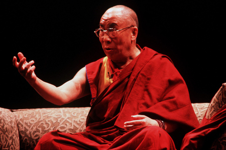 dalai: AUCKLAND - APRIL 10 2003: His Holiness the 14th Dalai Lama of Tibet is giving a speech in Auckland  New Zealand in April 10 2003. He has lived in exile in India since the Chinese Army crushed an uprising in his homeland in 1959.