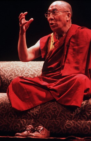 exile: AUCKLAND - APRIL 10 2003: His Holiness the 14th Dalai Lama of Tibet is giving a speech in Auckland  New Zealand in April 10 2003.He has lived in exile in India since the Chinese Army crushed an uprising in his homeland in 1959.