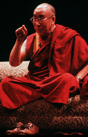 dalai: AUCKLAND - APRIL 10 2003: His Holiness the 14th Dalai Lama of Tibet is giving a speech in Auckland  New Zealand in April 10 2003.He has lived in exile in India since the Chinese Army crushed an uprising in his homeland in 1959.