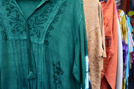 asian and indian ethnicities: Indian men shirts for sale in the market. Backgrounds and textures