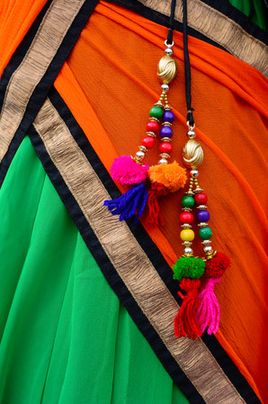 wedding accessories: Details of Indian festive woman dress. Background and texture