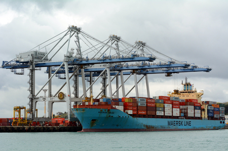 australasia: AUCKLAND,  NZL - OCT 13 2015:Big cargo ship unloading containers in Ports of Auckland New Zealand.It's New Zealands busiest port and the third largest container terminal in Australasia. Editorial