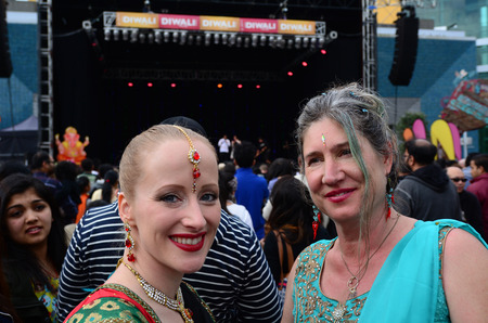 indian ethnicity: AUCKLAND,  NZL - OCT 18 2015:New Zealanders women celebrating Diwali festival in Auckland,New Zealand.Its the most ancient and biggest Hindu festival in India celebrated in autumn every year Editorial