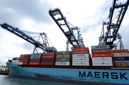 AUCKLAND - OCT 13 2015:Maersk Line cargo ship unloading containers in Ports of Auckland New Zealand.It is the worlds largest container shipping company operates over 600 vessels worldwide.