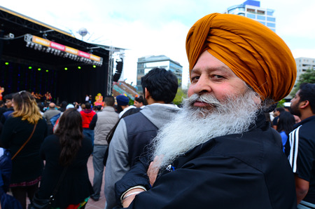 identidad cultural: AUCKLAND,  NZL - OCT 18 2015:Mature Indian man celebrating Diwali festival in Auckland,New Zealand.Its the most ancient and biggest Hindu festival in India celebrated in autumn every year