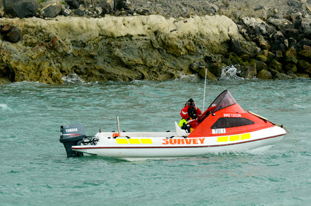 authorisation: AUCKLAND -  OCT 13 2015:Officer in a Hydrographic Survey boat.The division carries out all surveys to meet Ports of Aucklands requirements on the Waitemata and Manukau Harbours. Editorial