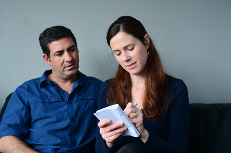 the spouse: Couple planning their life the living room. Spouse relationship concept Stock Photo
