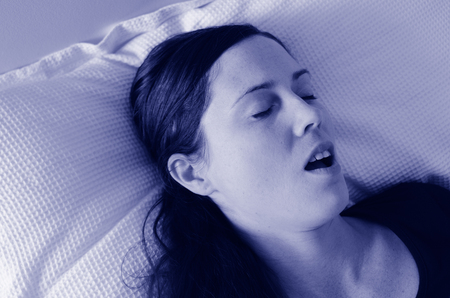 thirties: Young woman in her thirties (30s) snoring in bed. Health care concept (BW)