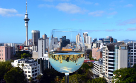 sauvignon: Reflection of Auckland New Zealand skyline inside a White wine, Sauvignon Blanc, glass. Stock Photo