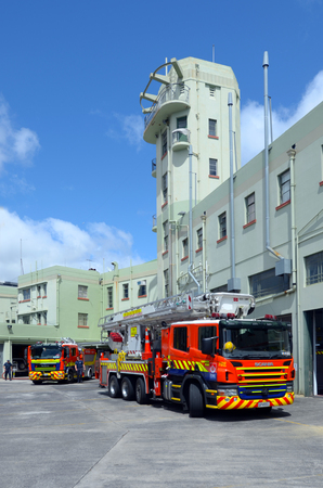 permanently: AUCKLAND  - OCT 27 2015:Fire engines in Auckland City Fire Station in Auckland New Zealand.Its one of the 3 largest in New Zealand, and is the largest permanently staffed stations in Auckland Region.