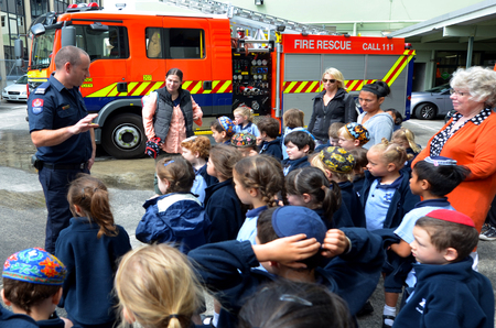 public schools: AUCKLAND  - OCT 27 2015:Fire Safety Education day in Auckland City Fire Station, New Zealand.Each year over 20,000 fires are attended by New Zealand Fire Service, including nearly 5,000 house fires. Editorial